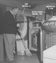 Harold Meier sweeping in his jukebox treasure house
