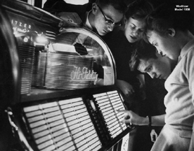 Teenagers playing a Jukebox